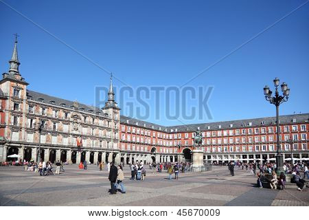 MADRID - MARCH 9: People walk at Plaza Mayor, on March 9 2012 in Madrid, Spain. People from the UK, Germany, France and Russia - is a major part of tourists to Spain in 2012.