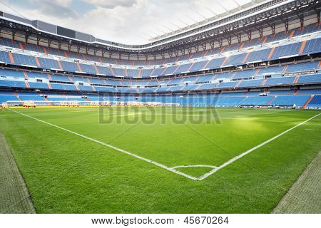MADRID - MARCH 8: Green lawn with marking of Santiago Bernabeu stadium on March 8, 2012 in Madrid, Spain. Stadium was built in 1947, is named after mud Real Madrid president Santiago Bernabeu.