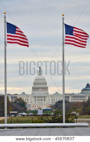 United States Capitol building and US flags around Washington Monument  - Washington DC