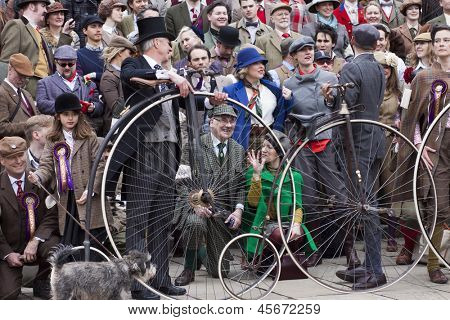 "LONDON - APR 13: Unidentified participants taking a group picture after finishing the London Tweed run contest, ""a metropolitan bicycle ride with a bit of style"" on April 13th, 2013 in London, UK."