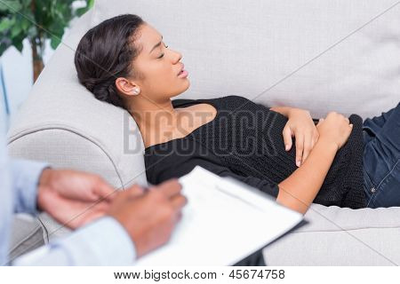 Woman at therapy with therapist taking notes