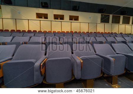 Conference room with comfortable gray cloth seats.