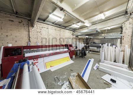 Large printer for large format printing is in the printing house.