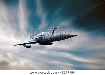 Military airplane on the speed in the sky