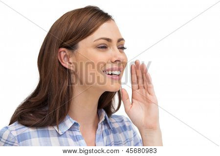 Smiling woman placing her hand to say something on white background