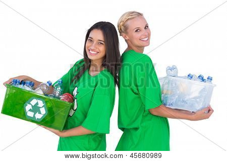 Enivromental activists holding box of recyclables and standing back to back happily on white background