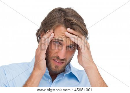 Tanned man having a strong headache on white background