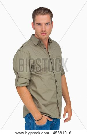 Frowning man looking at camera on white background
