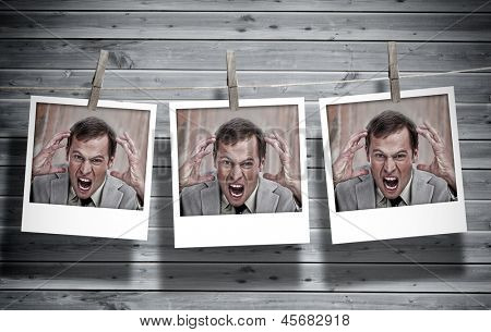 Three instant photos of an angry businessman hung with pegs with wooden boards on the background