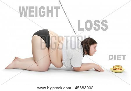 Funny picture of an hungry obese woman chained near plate with food. Weight loss concept. Picture with space for your text.