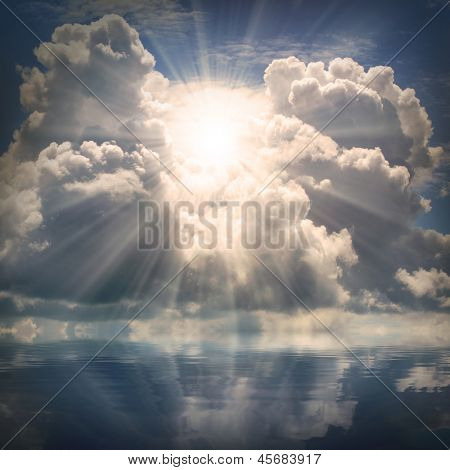The sun on dramatic sky over sea. Natural background. Forces of nature concept.