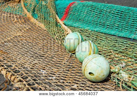 Laying corks and fishing nets outdoor