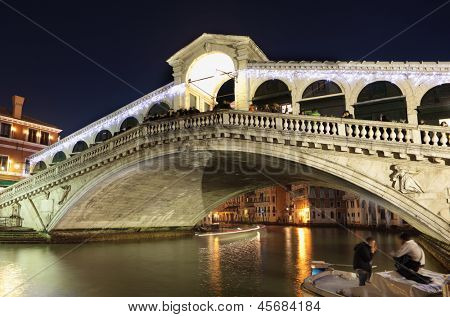 VENICE, ITALY - DECEMBER 31: Tourists on the Rialto bridge in Venice, Italy on December 31, 2012. Rialto is the oldest bridge across the Grand Canal