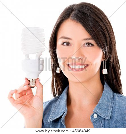 Happy woman with an energy saving bulb - isolated over white background