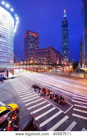 TAIPEI, TAIWAN - JANUARY 18: Traffic in the Xinyi District January 18, 2013 in Taipei, TW. Several key buildings such as Taipei 101 are located in Xinyi making it the financial district of the city.