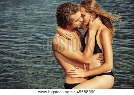 Beautiful young couple in love  having holidays on the sea.