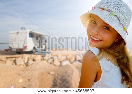 Travel with camper, summer beach - beauty girl on summer vacation