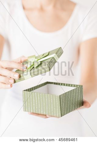 close up of woman hands opening  gift box.