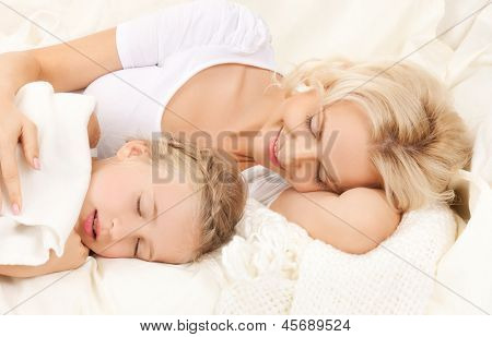 picture of happy mother and daughter sleeping