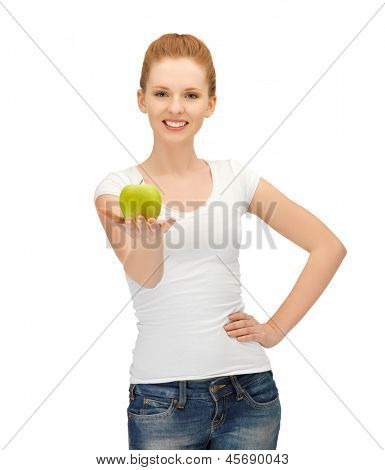 beautiful young woman in blank t-shirt eating green apple