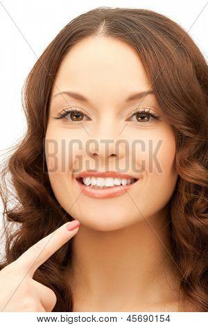 face of beautiful woman touching her chin