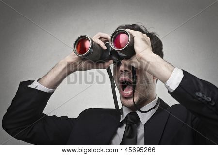 businessman looking with binoculars