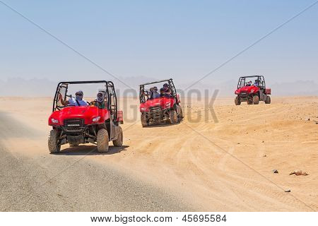 HURGHADA, EGYPT - APR 16: Unidentified people at quad trip on the desert near Hurghada on 16 April 2013. Desert safari is one of the main local tourist attraction in Egypt.
