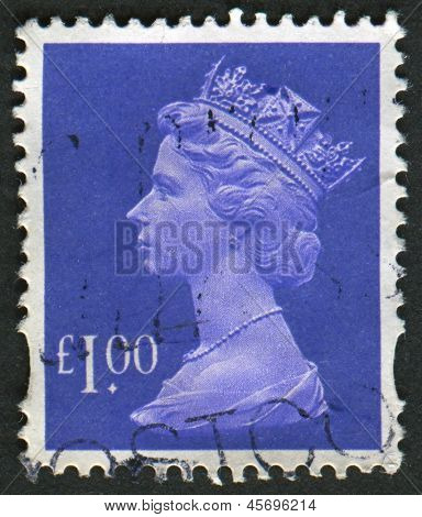 UK-CIRCA 1995: A stamp printed in UK shows image of Elizabeth II is the constitutional monarch of 16 sovereign states known as the Commonwealth realms, in Bluish Violet, circa 1995.