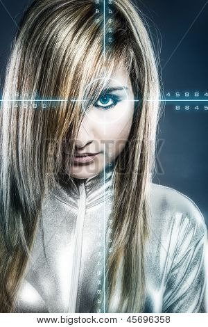 communications concept, young blonde with silver latex jumpsuit blue signs
