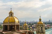 image of guadalupe  - Old basilica of Guadalupe with Mexico City cityscape in the background - JPG