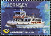 A stamp printed in Guernsey shows a ship circa 1994