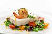 image of halibut  - Poached halibut with spicy shrimp green beans cherry tomatoes black olives and citrus sauce - JPG