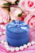 Rose and gift box on pink cloth