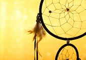 stock photo of cord  - Beautiful dream catcher on yellow background - JPG