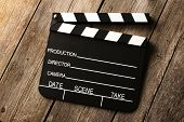 Movie production clapper board over wooden background