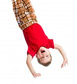 stock photo of upside  - kid boy upside down isolated on white - JPG