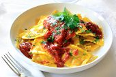 stock photo of italian parsley  - Ravioli with bolognese sauce - JPG