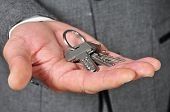 picture of eviction  - a man wearing a suit with a key ring in his hand - JPG
