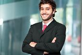 stock photo of commutator  - Portrait of an handsome businessman outdoor in the city - JPG