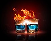 image of absinthe  - Image of two glasses of burning emerald absinthe - JPG