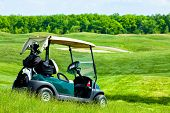 stock photo of caddy  - green Golf club car at golf field - JPG