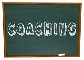 stock photo of role model  - The word Coaching on a blackboard or chalkboard to symbolize learning - JPG