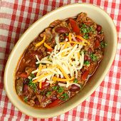 Beef chili with cheese.