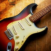 stock photo of fret  - Sunburst color double cutaway electric solid body guitar - JPG
