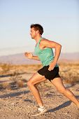 Runner sport man running and sprinting outside training in healthy lifestyle. Male fitness sports mo