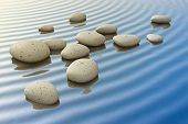 An image of a nice zen background with white stones in the water