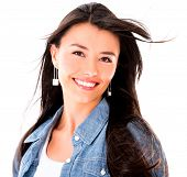 Beautiful woman with windy hair smiling - isolated over white