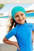 Summer vacation, summer joy - lovely surfer girl in the beach resort, active child concept