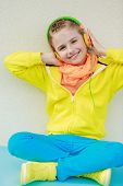 Young girl with headphones enjoying music . Lifestyle of young people concept.