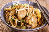 stock photo of egg noodles  - stir fried noodles with chicken and vegetables - JPG